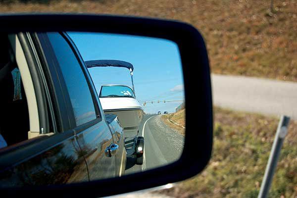 Photo of towing boatview through the rear-view mirror