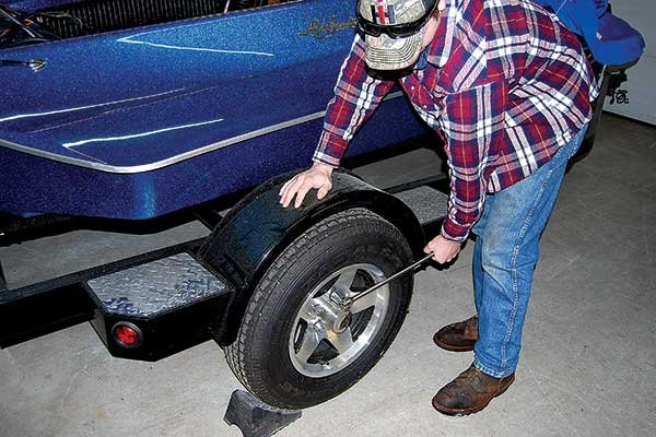 Photo of using a wrench to loosen lug nuts