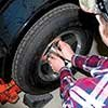Thumbnail photo of replacing lug nuts on a trailer tire