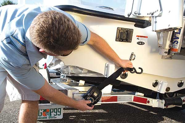 Photo of attaching a ratch strap to a boat