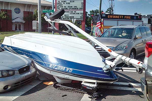 Photo of a boat and car collision