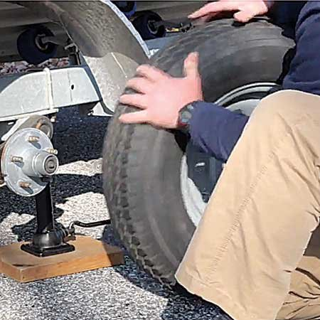 Photo of changing a trailer tire