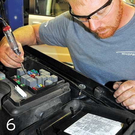 Photo of running the compressor wiring to the vehicle's main fuse panel
