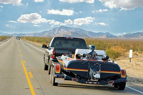 Photo of towing a powerboat along the highway