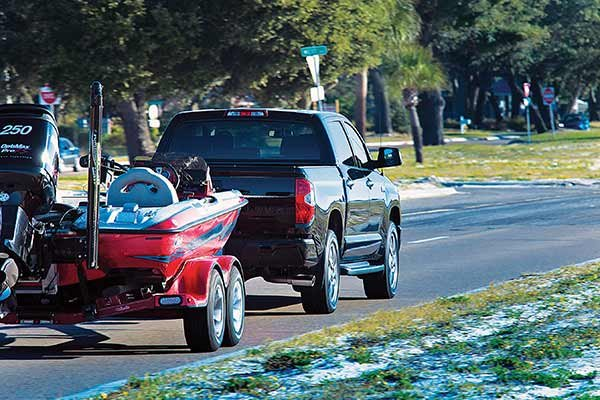 Photo of a Ford Tundra towing powerboat on a residential street