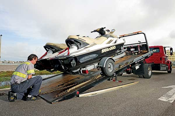 Photo of a broken down trailer being towed