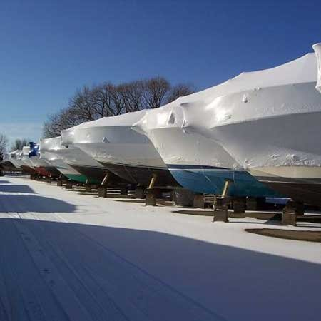 Photo of covered boats in winter