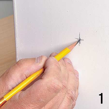 Photo of marking the spot with pencil for 20-amp socket