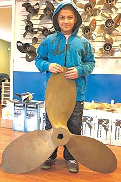 Photo of author's nephew demonstrating prop diameter