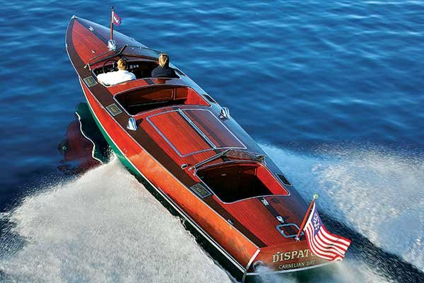 Wooden powerboat cruising Lake Tahoe