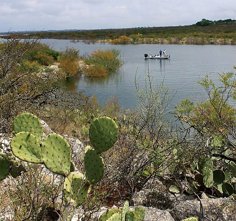 Photo of two men fishing on Lake Amistad