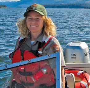 Photo of park ranger Beth Lariviere on her Boston Whaler