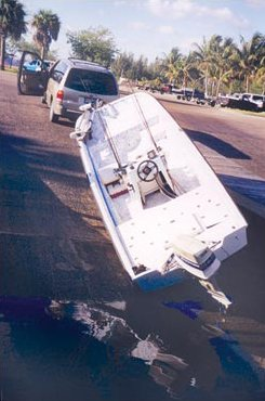 Photo of a boat laying sideways on the boat ramp