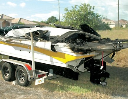 Photo of a boat damaged by a fire