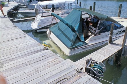 Photo of partially sunken boat