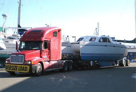 Photo of a boat on a large flatbed truck