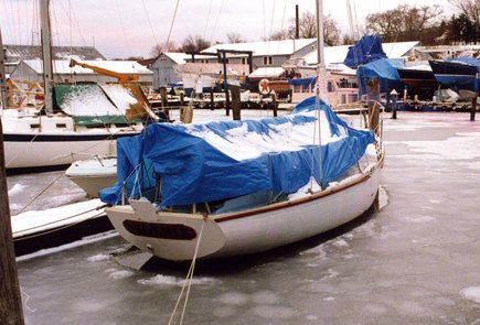 Photo of boat with the boat cover fill of snow