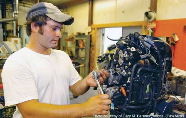 Mechanic working on boat engine