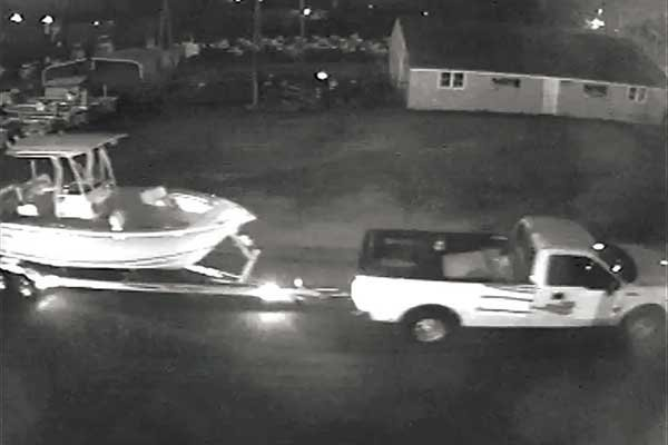 Surveillance camera footage of thieves making off with a trailerable boat