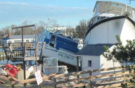 Photo of two boats tied together causing damage to neighbors property