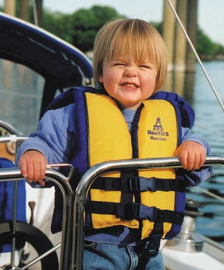 Photo of cute kid in a life jacket