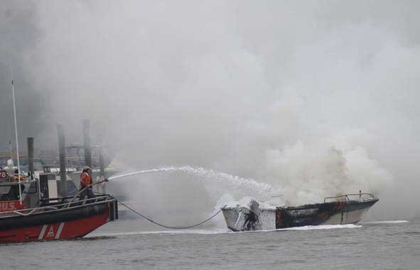 Photo of boat fire being put out
