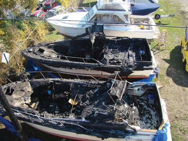 Photo of fire-damaged boats
