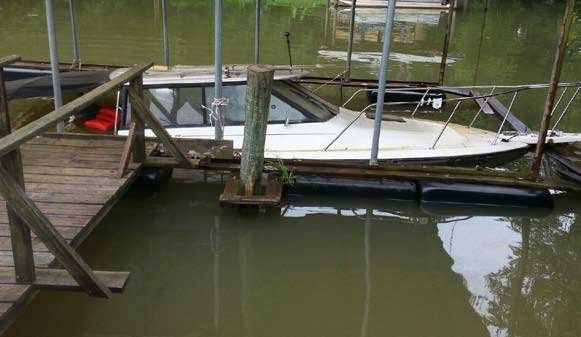 Photo of a submerged boat at a dock