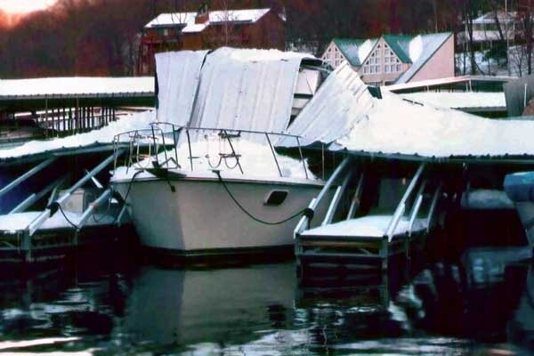 Photo of wind-damaged boats docked at a marina