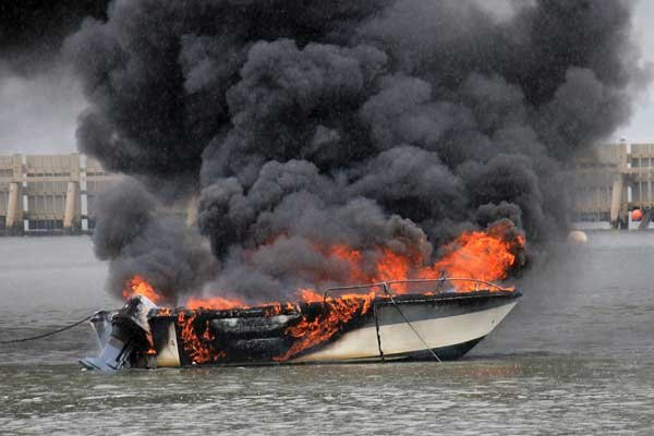 Photo of a powerboat on fire on the water