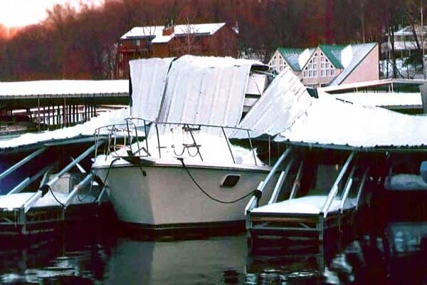 Photo of siding collapsed onto boat