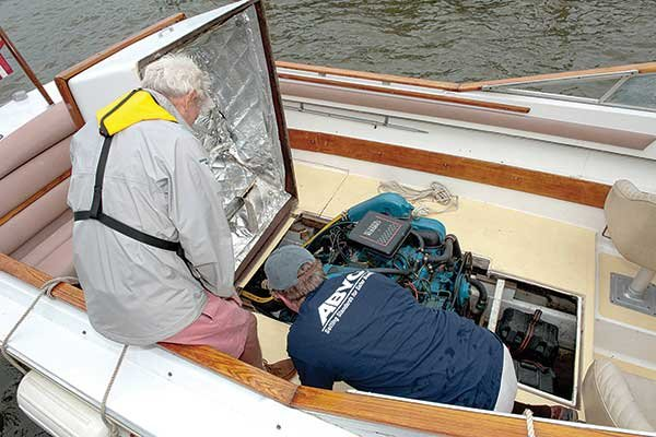 Photo of inspecting boat engine