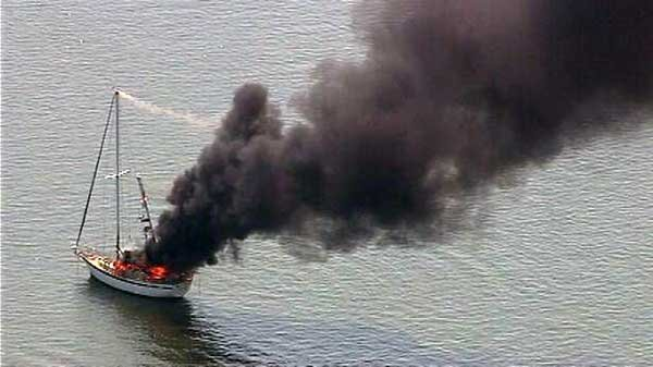 Photo of a powerline boat fire