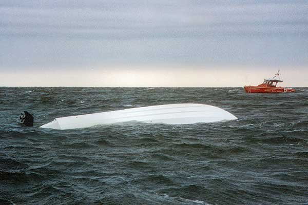 Capsized boat in a storm