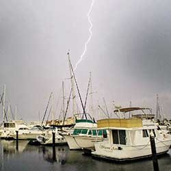 Thumbnail photo of lightning over marina