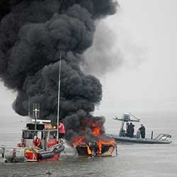 Thumbnail photo of responding to a boat fire