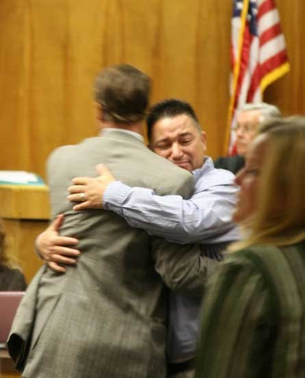 Photo of Bismarck Dinius hugging his attorney Victor Haltom after the verdict