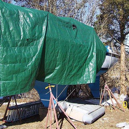 photo of plastic tarp over boat
