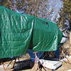 Thumbnail photo of a plastic tarp boat cover