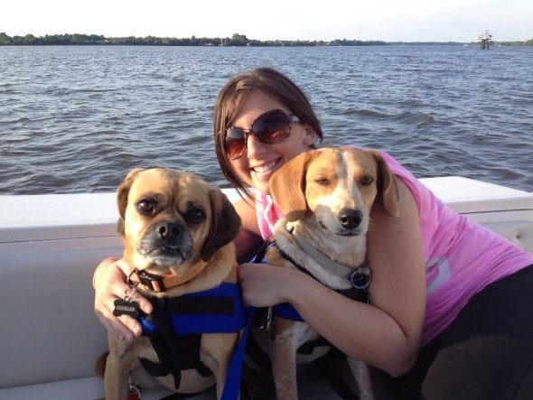Photo of a BoatUS Member and her dogs