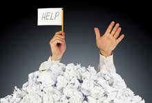 Thumbnail photo of waving the white flag through mounds of paper