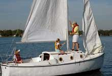 Photo of a family learning to sail