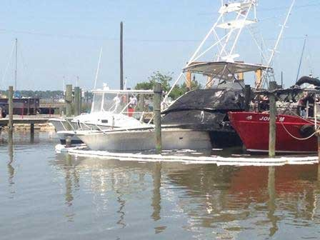 Photo of salvage of 50 foot sport fishing boat