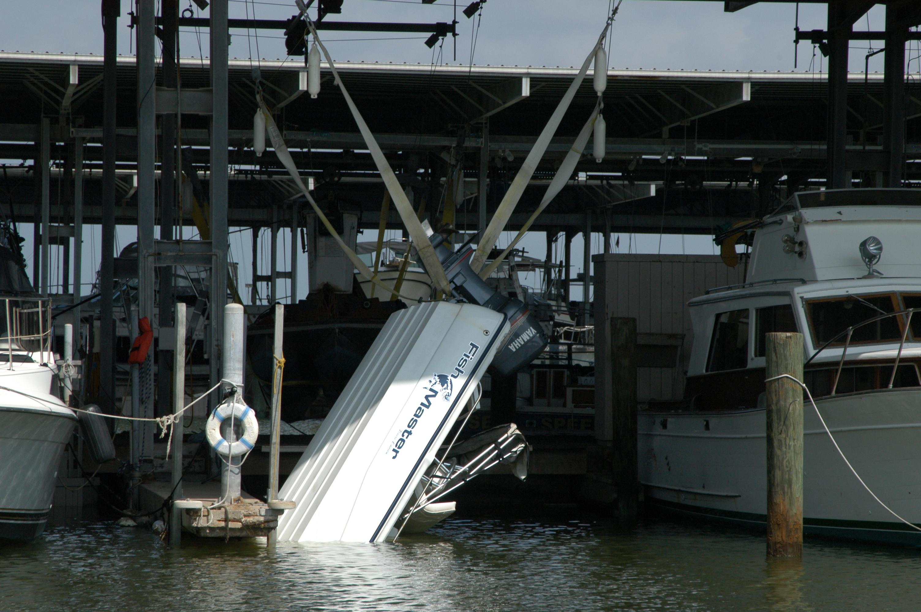 Damaged boats photos press room boatus for Outboard motor lifting strap